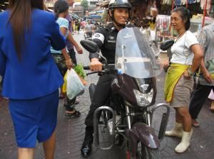 A Thai policeman (many policemen drive motorbikes)
