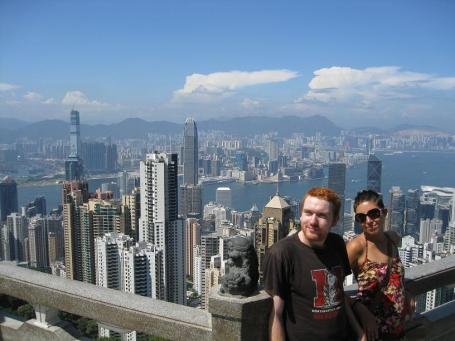 a friend and me stand on Victoria Peak overlooking central Hong Kong